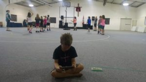 School on-the-go... The Boy is working on Money Concepts during Sweetness and Bookworm Beauty's basketball camp!